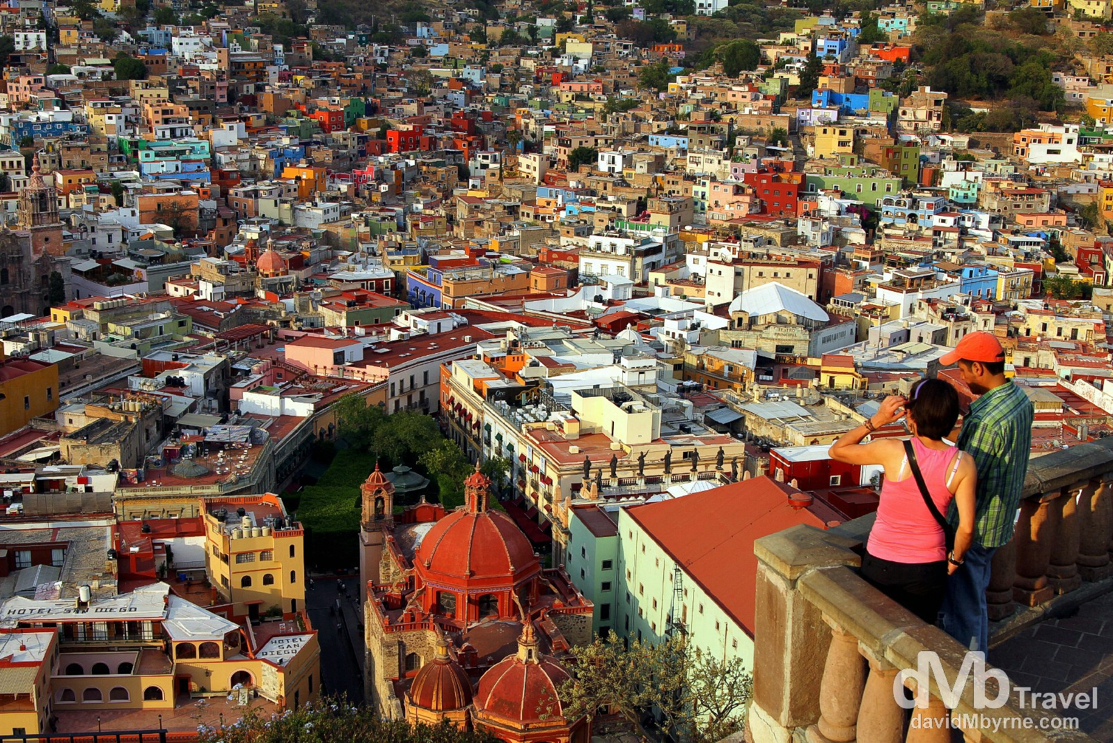 Overlooking UNESCO World Heritage listed Quanajuato as the sun sets from Panoromica. Riding the (very short) Funicular from behind Teatro Juarez to the top of San Miguel Hill is one of the must-do Guanajuato activities - you could of course walk up or, better still & as I did, get the funicular up and get lost in the jumble of photographic lanes by walking down (it's not far). This vantage point is visible from all over the city as it houses a 28-metre-tall statue, called El Pipila, of an independence hero who wore a stone slab on his back to protect himself while burning the Spanish troops holed up in the city's  Alhóndiga, or granary, in September 1810. The views here are spectacular, especially towards the end of the day when the light is at its softest. Guanajuato, Mexico. April 23rd 2013.