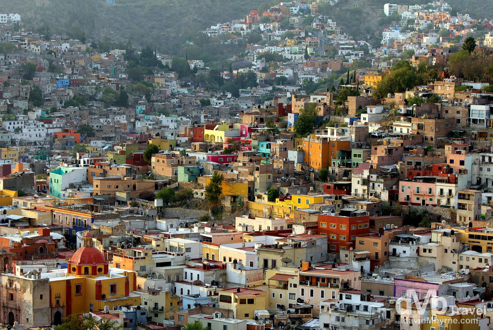 The city of Guanajuato is very compact, which means you can walk just about everywhere of interest. That said, it's very hilly, the result of being located in a ravine in the Sierra de Media Luna - virtually every point in the city is on a slant. But ignore all that. Just walk. Meander the numerous sinuous and narrow streets, all lined with multi-storied, brightly painted colonial homes. Go up those endless stairs, or down into the unknown, through one of the many dark, unique one-way tunnels. Go left, until you hit a dead end. Go back and go right. It'll bring you somewhere fascinating. Explore. Get lost, if you can. It's so much fun. Oh, and don't forget your camera. Please don't forget your camera. Not here. Guanajuato, Mexico. April 23rd 2013.