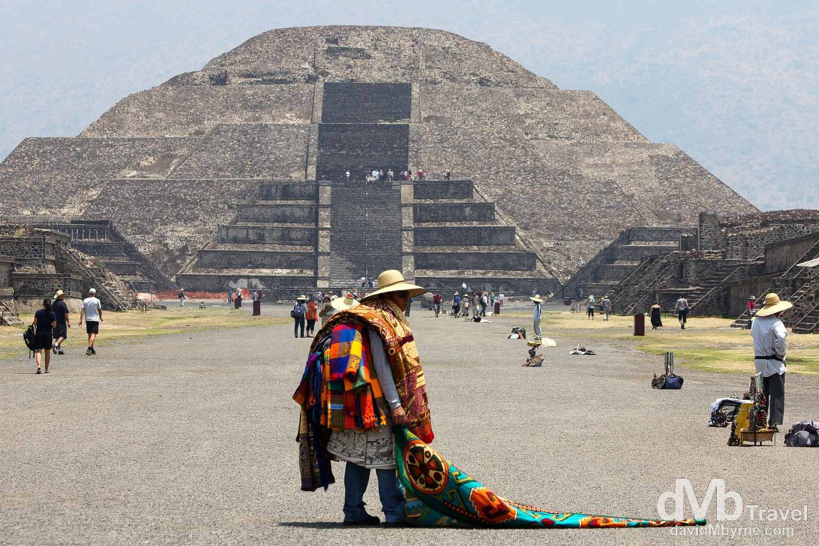 A hawker on Calzada de los Muertos (the Avenue of the Dead) in full view of the Piramide de la Luna (Pyramid of the Moon) in Teotihuacan, Mexico. April 29th 2013.