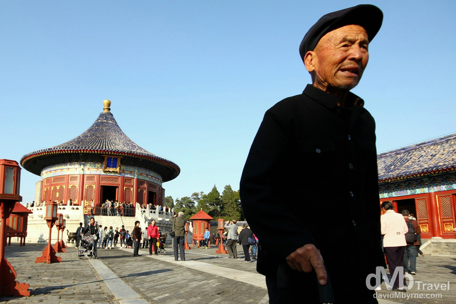 A man in the compound of the Imperial Vault of Heaven in the grounds of the Temple of Heaven complex, Beijing, China. October 27th 2012.