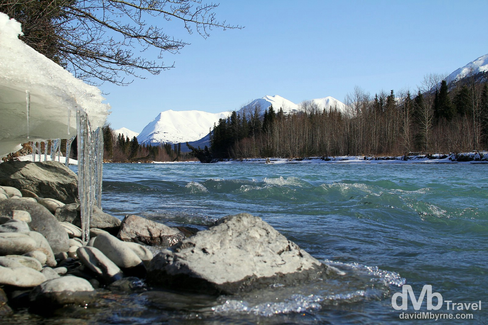 Ice hangs from a snowy overhang by a river beside the Sterling Highway near Kenai National Wildlife Refuge on the Kenai Peninsula, Alaska, USA. March 18th 2013.