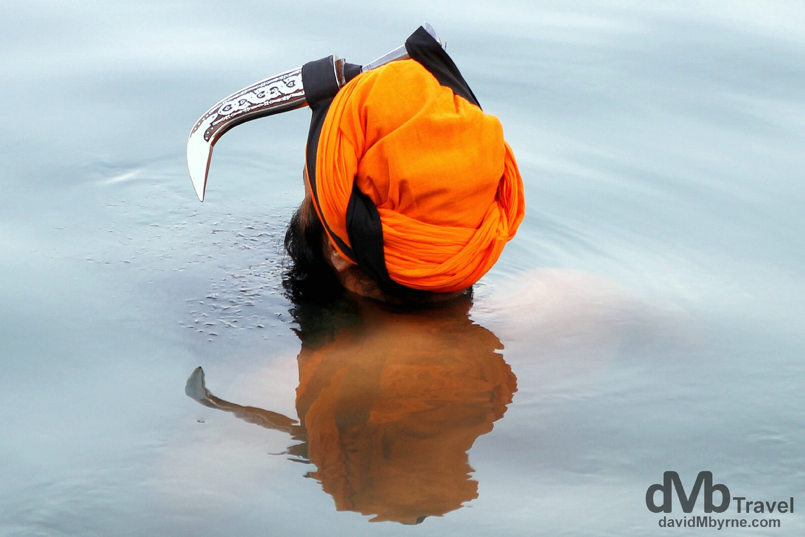A Sikh devotee in the Amrit Sarovar (Pool of Nectar) in the Golden Temple complex, Amritsar, India. October 9th 2012.