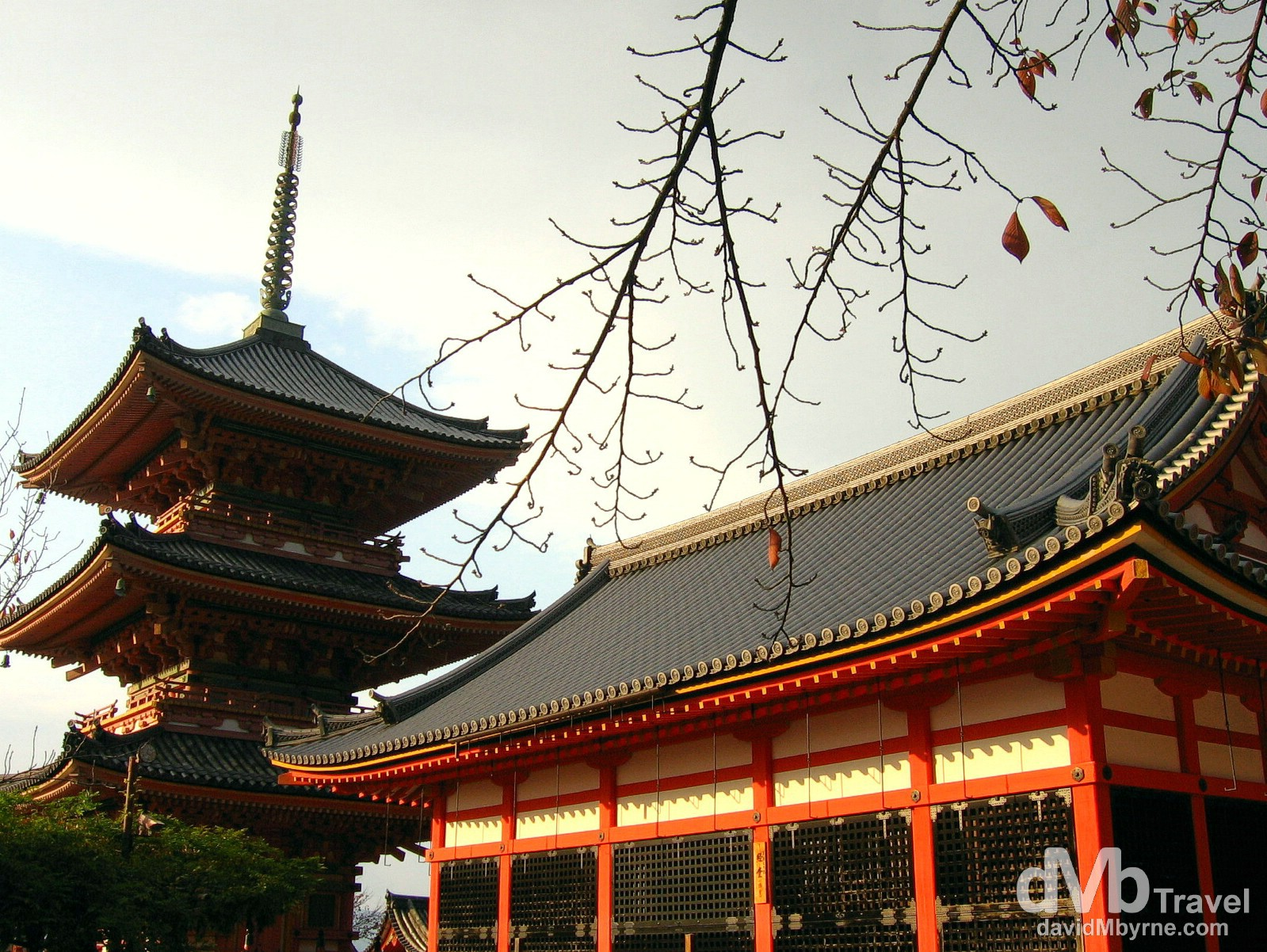The three-storied pagoda (and another orange building) in the grounds of the Kiyomizu-dera temple. The temple originated in 778 and remains associated with the Hosso sect, one of the oldest sects within Japanese Buddhism. In 1994 the temple was added to the list of UNESCO world heritage sites, having being recognised as 'a place of exceptional and universal value; a cultural heritage site worthy of preservation for the benefit of all mankind'. Kiyomizu-dera Temple, Higashiyama-ku, Kyoto, Japan. November 20th 2007.