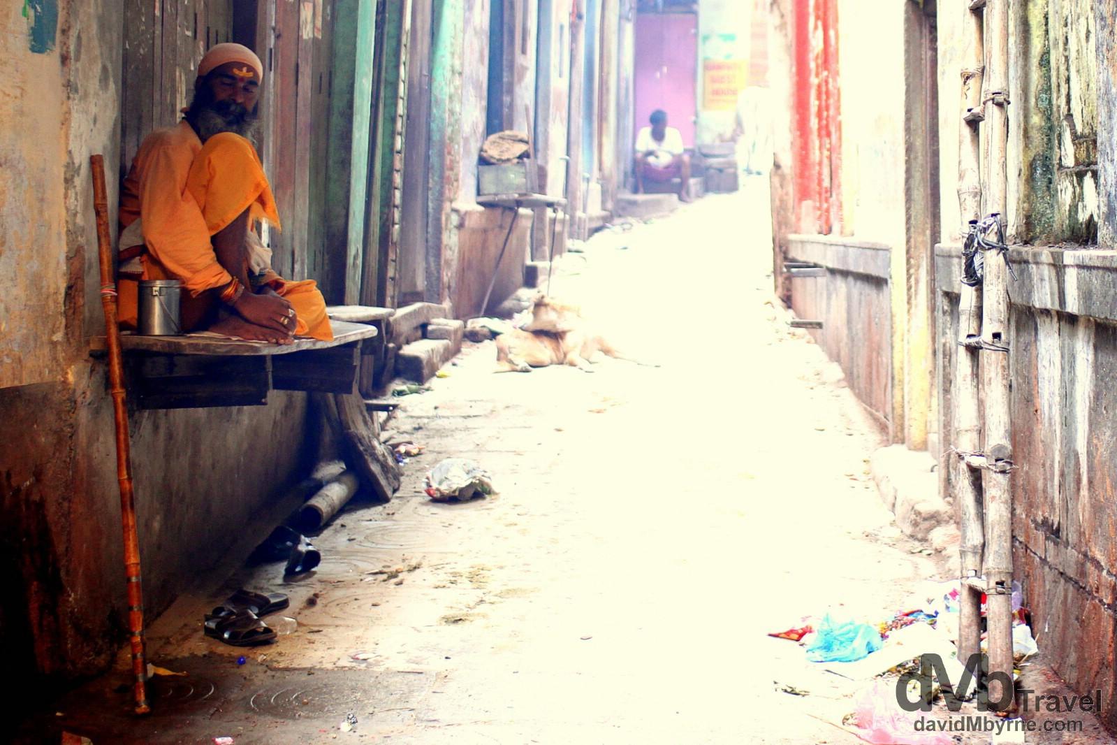 A sadhu sitting in a lane in the Old City of Varanasi, Uttar Pradesh, India. October 14th 2012.
