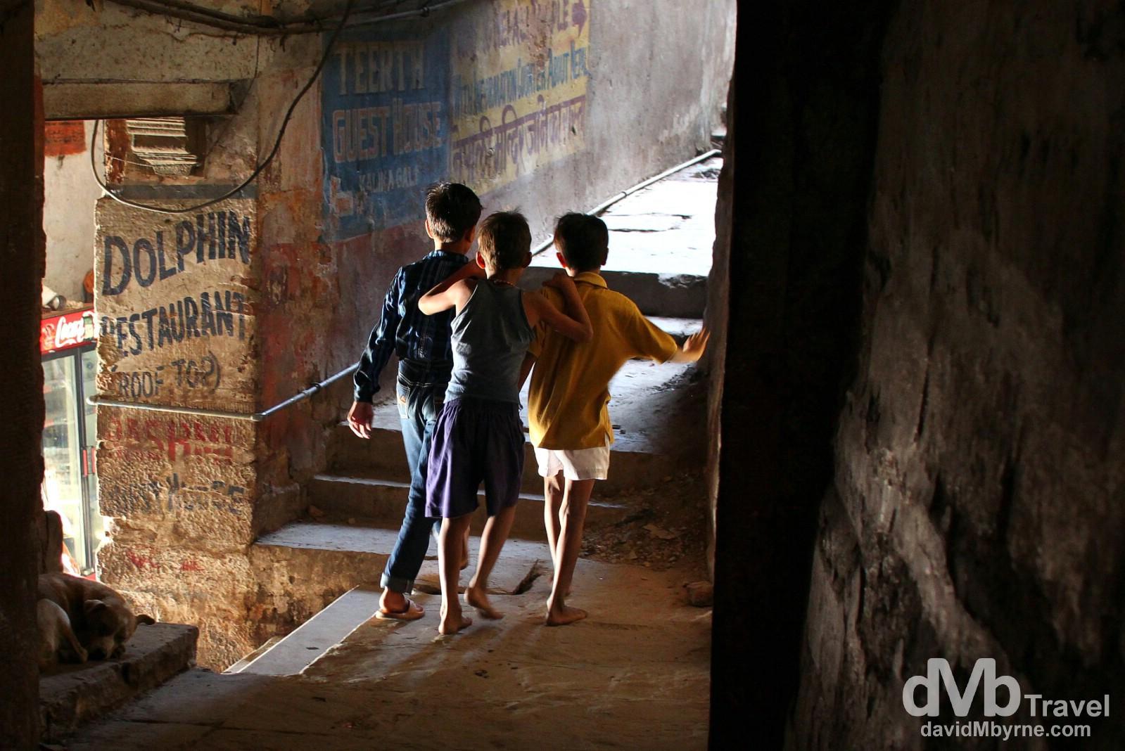 Mischievous boys in a lanes of old town Varanasi, Uttar Pradesh, India. October 14th 2012.