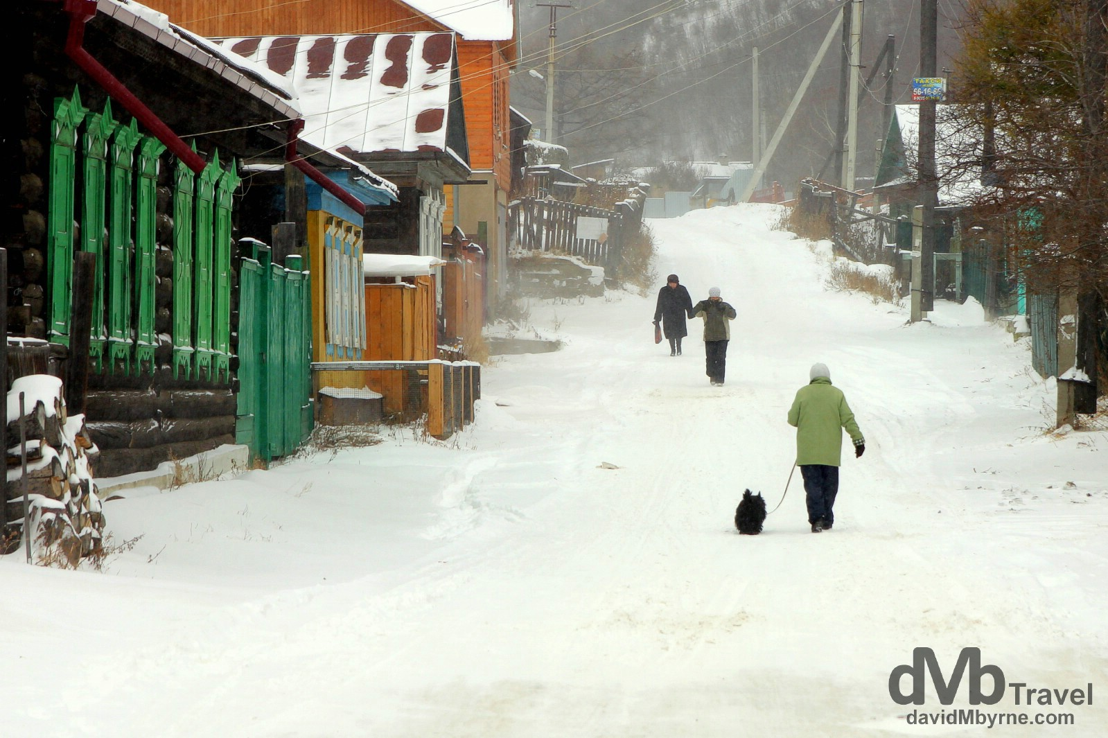Walking in the snow in the village of Listvyanka on the shores of Lake Baikal, Irkutsk Oblat, Russia. November 9th 2012
