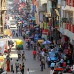 A view down the Main Bazaar in the traveller hangout of Paharganj in Old Delhi, Delhi, India. October 8th 2012.