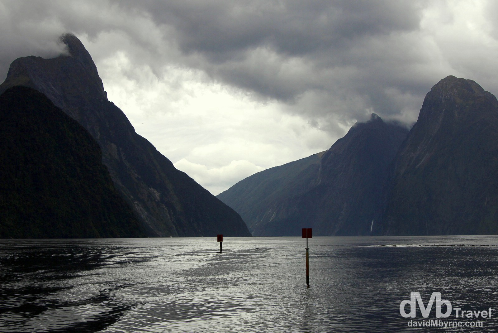 Cloud hovers over the peaks, including Mitre Peak (left), on a wet day in Milford Sound, South Island, New Zealand. May 26th 2012.