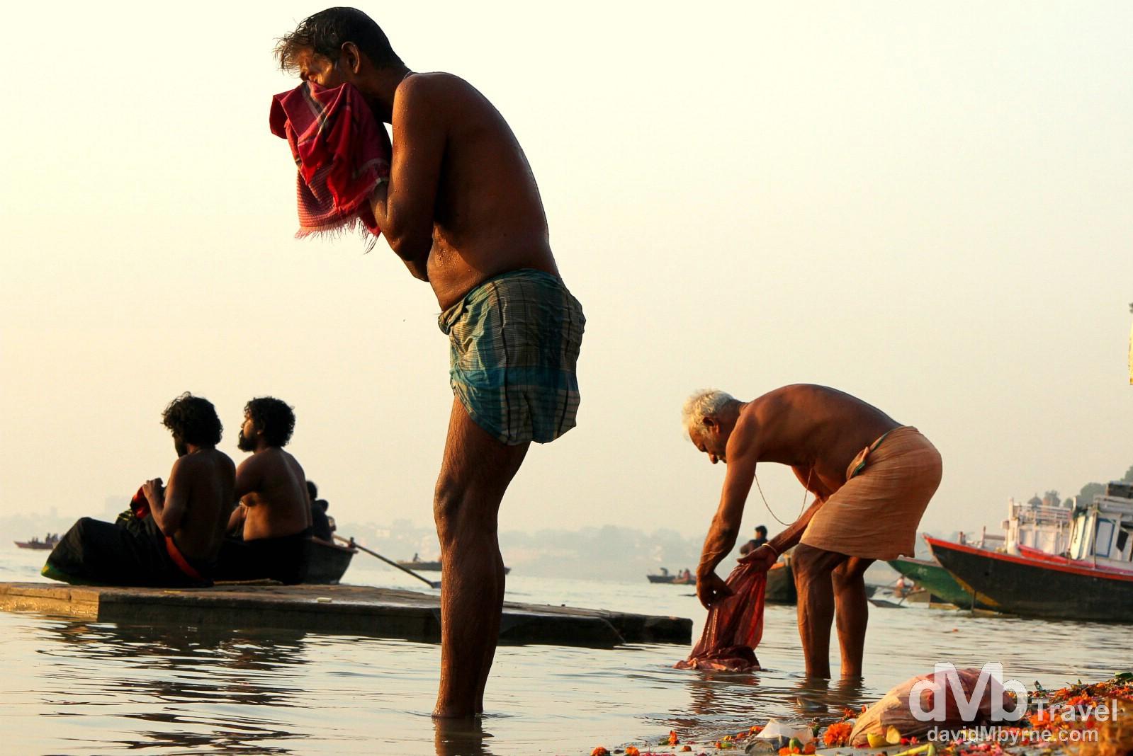Sunrise bathing in the River Ganges, Varanasi, Uttar Pradesh, India. October 13th 2012.