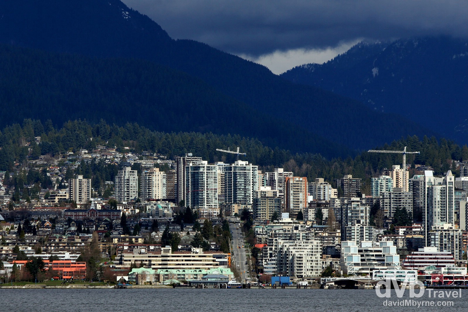 A picture of North Vancouver taken from the waters edge across Burrard Inlet in downtown Vancouver, British Columbia, Canada. March 20th 2013.