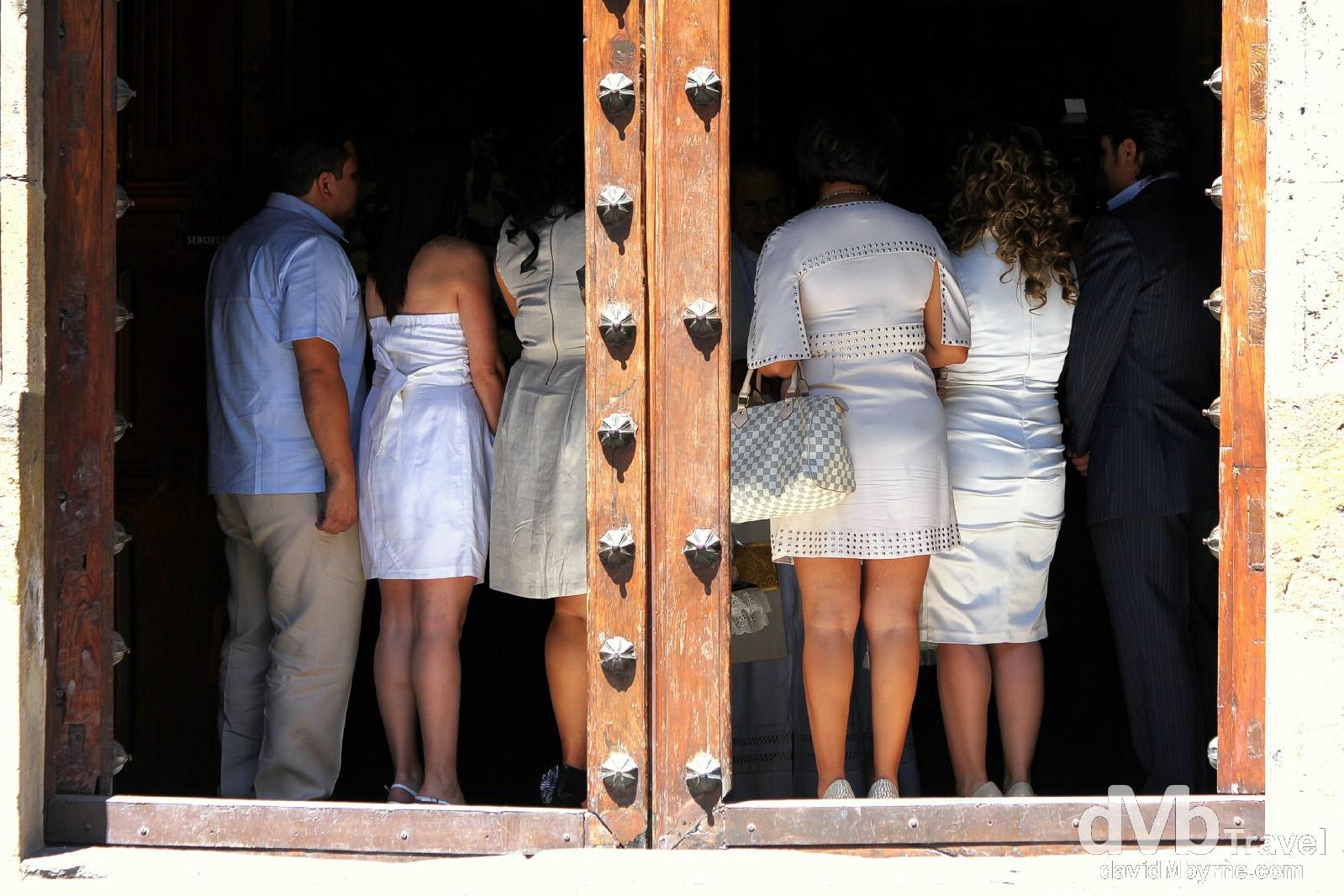 A section of a wedding party inside  Nuestra Senora del Carmen, Guadalajara, Mexico. April 20th 2013.
