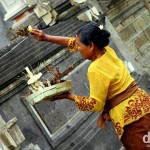 Making offerings in Ubud, Bali, Indonesia. June 20th 2012.
