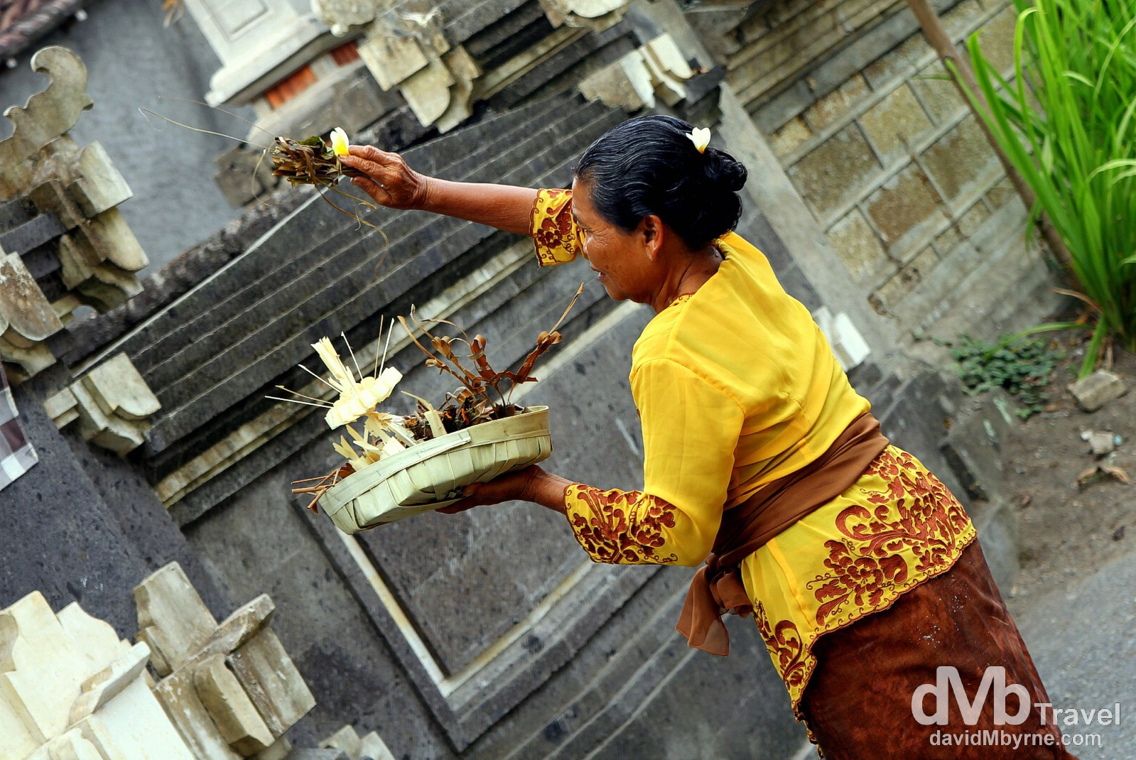 Making offerings in Ubud, Bali, Indonesia. June 20th 2012.