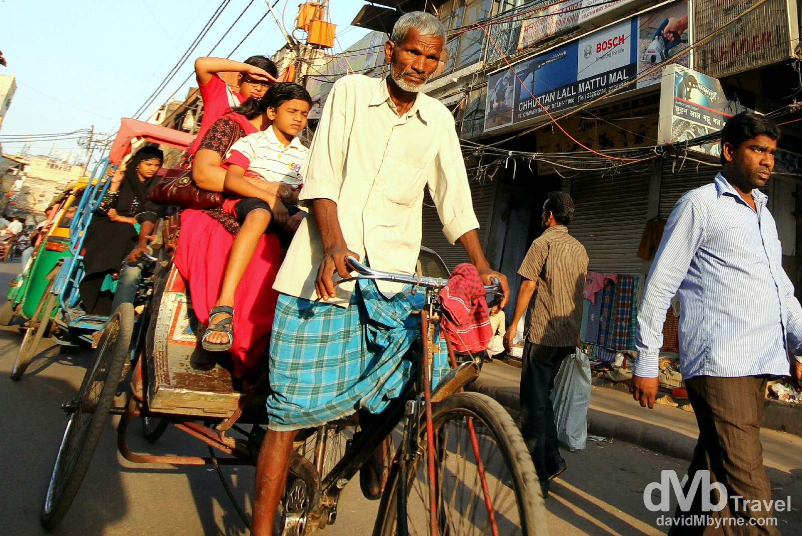 A cyclo (cycle rickshaw) on the streets of Old Delhi, Delhi, India. October 7th 2012.