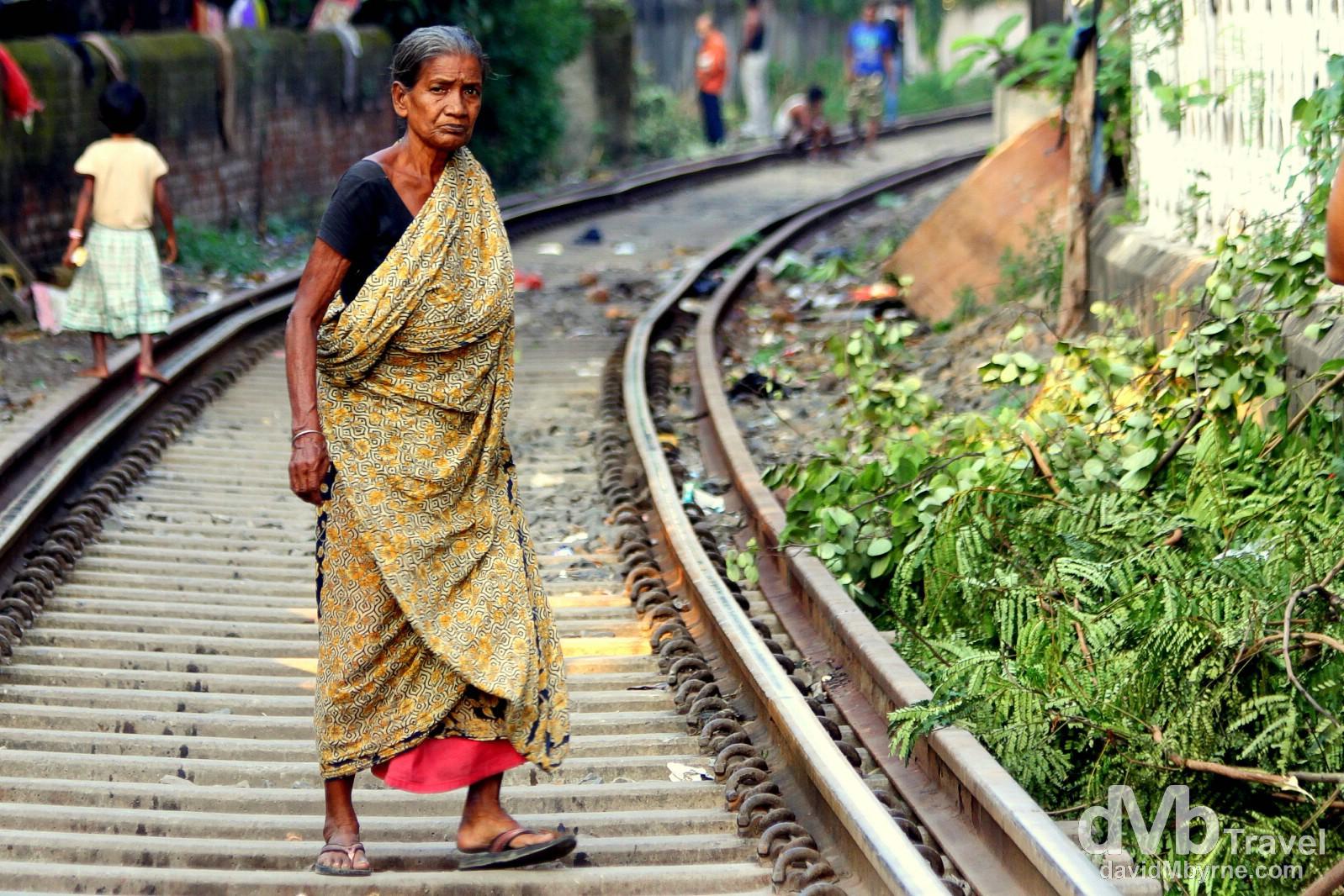 Crossing the train tracks near the Babu Ghat in Kolkata (Calcutta), West Bengal, India. October 15th 2012.