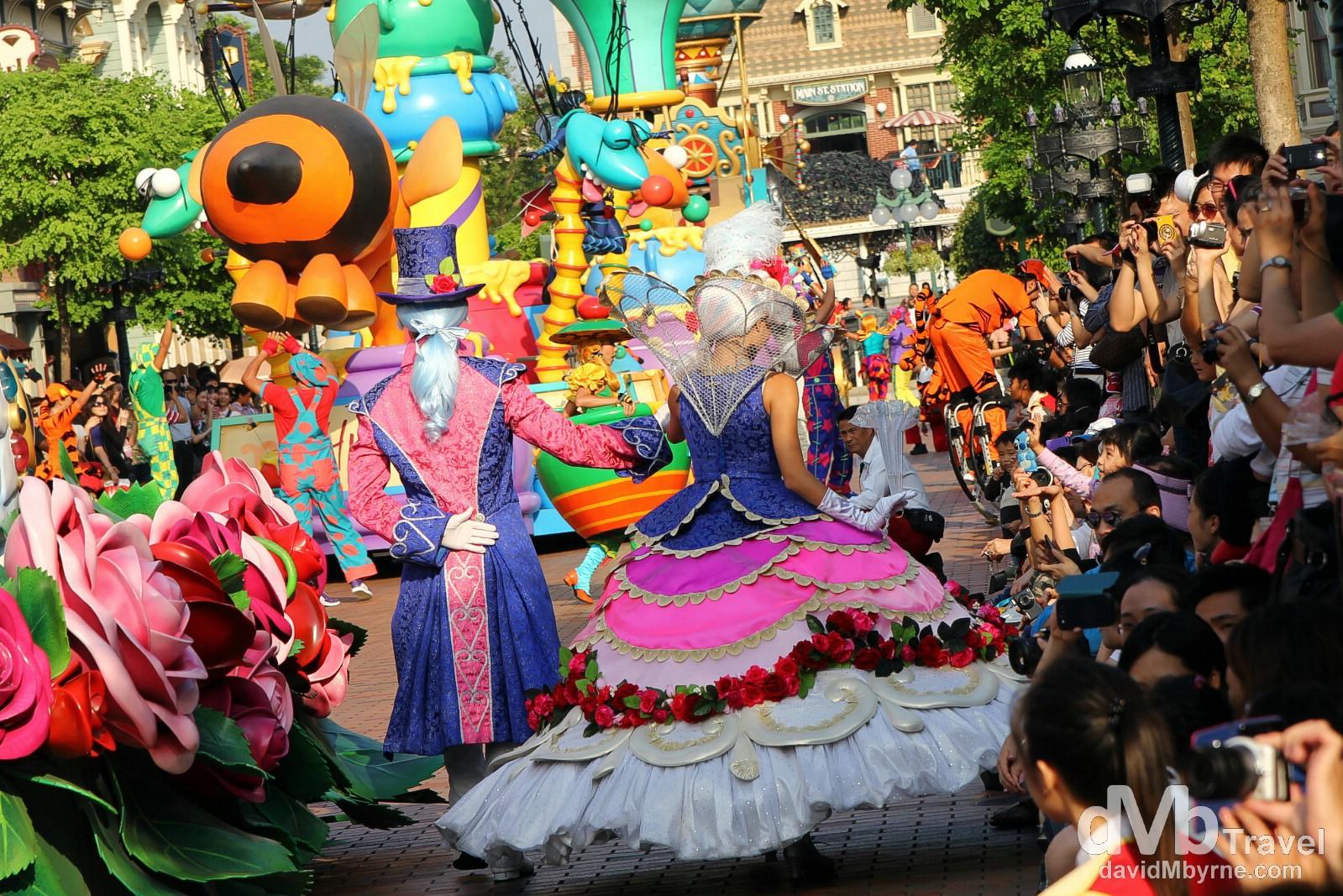 People enjoying the daily character parade at Disneyland Hong Kong. October 19th 2012.