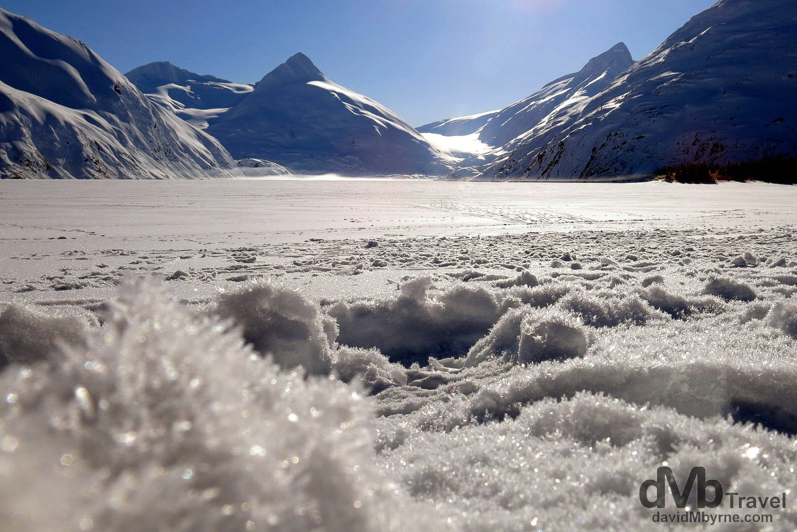 Portage Lake frozen with the Portage Glacier resting in the valley in the distance, Chugach National Forest, Kenai Peninsula, Alaska, USA. March 12th 2013.