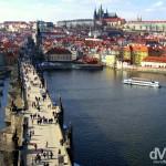 The medieval castle district across the Charles Bridge spanning the Vltava river in Prague, Czech Republic. March 8th 2006