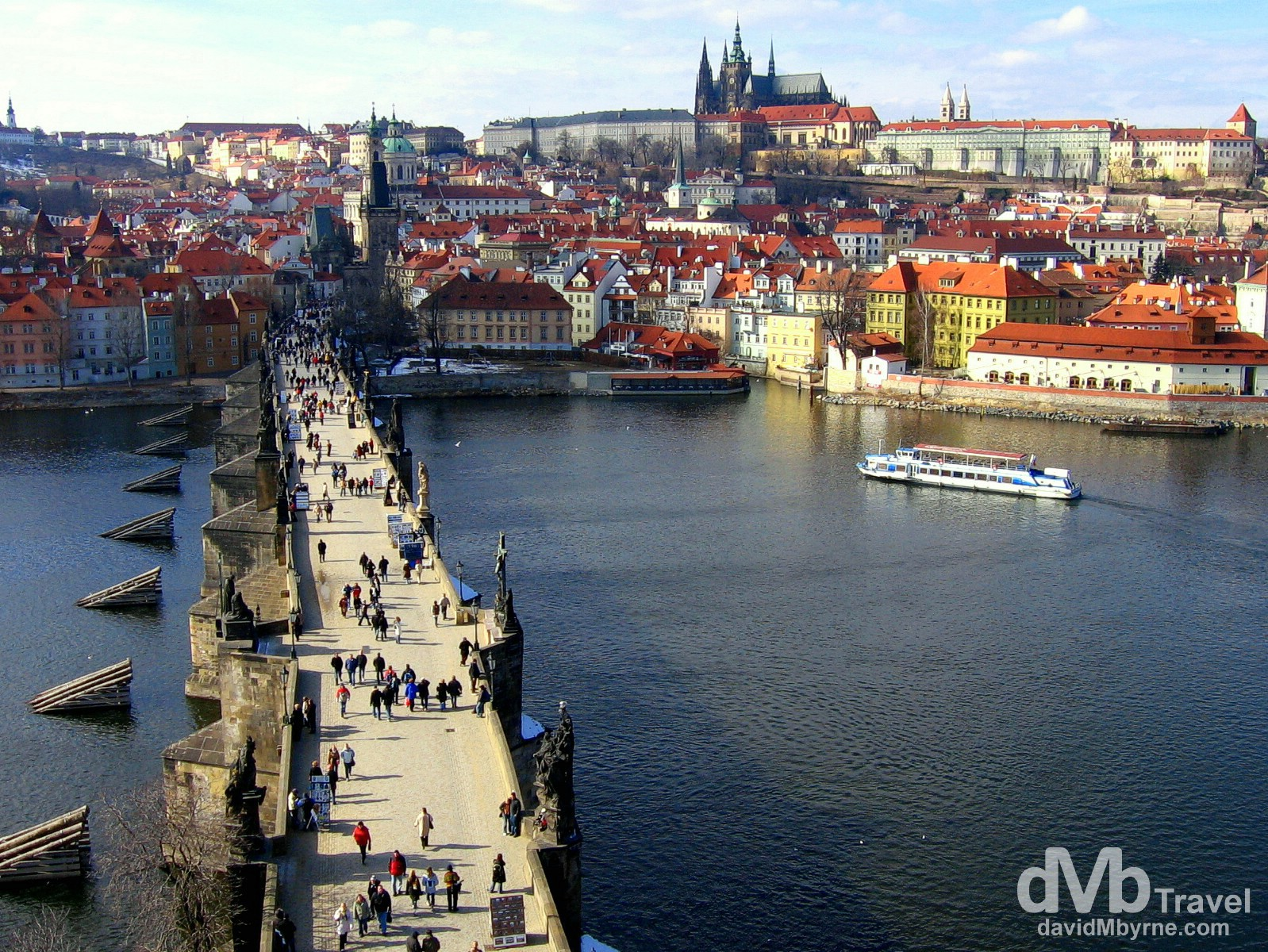 The medieval castle district across the Charles Bridge spanning the Vltava river in Prague, Czech Republic. March 8th 2006