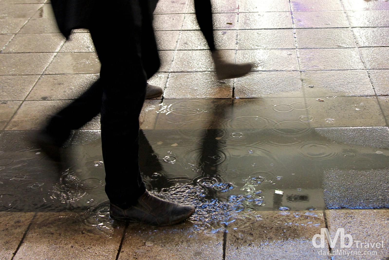 Puddles on Drottninggatan, Central Stockholm, Sweden. November 26th 2012.