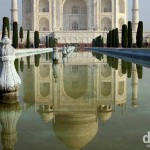 The Taj Mahal as seen reflected in the ornamental garden pool fronting it. Agra, Uttar Pradesh, India. October 11th 2012.