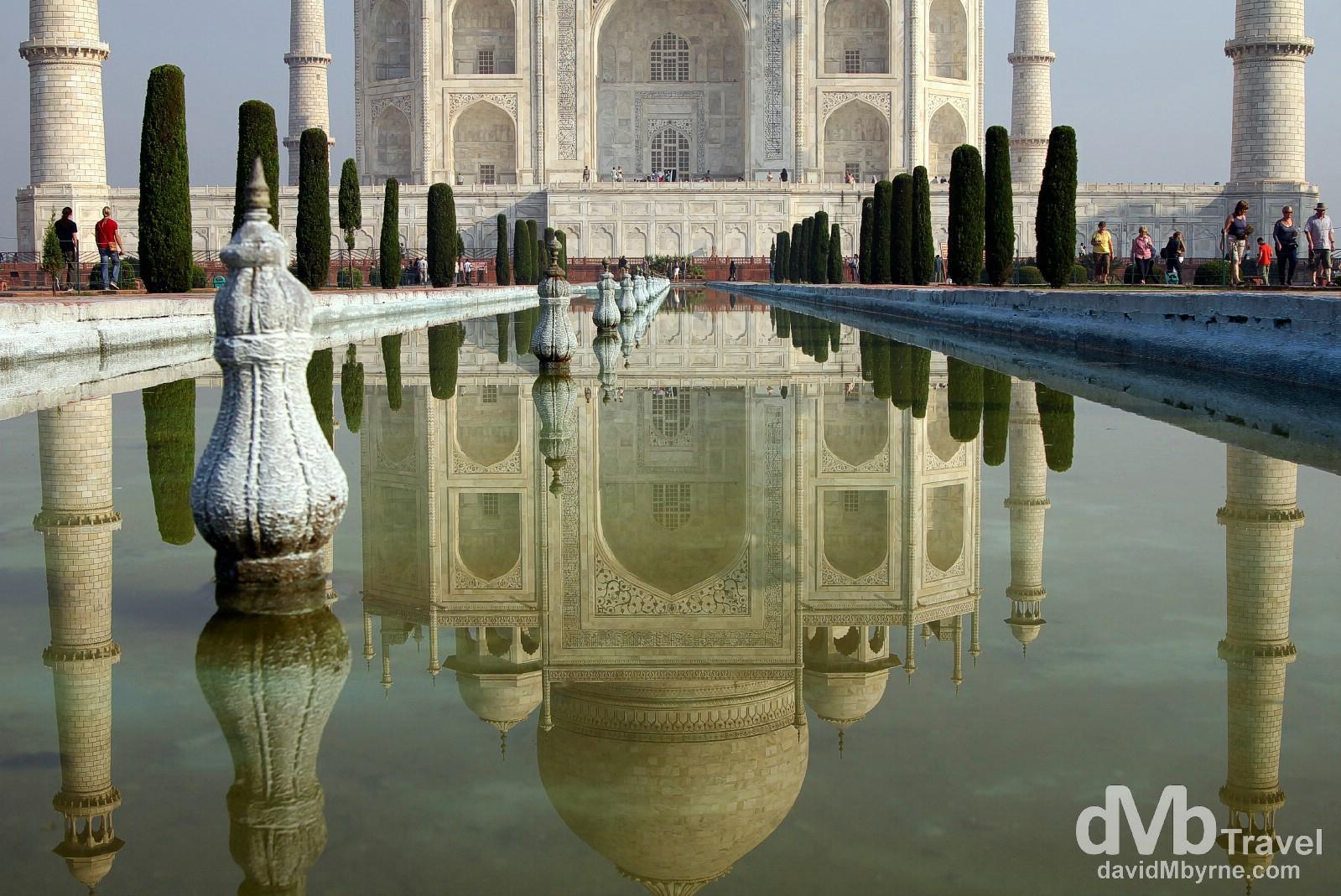 The Taj Mahal as seen reflected in the ornamental garden pool fronting it. Agra, Uttar Pradesh, India. October 11th 2012.