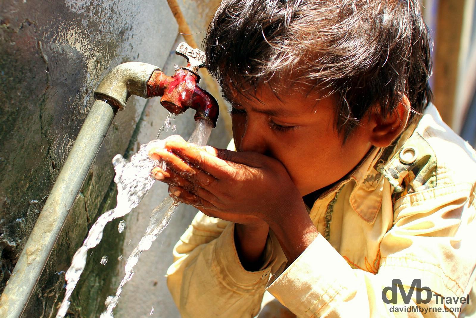 Rehydrating in the narrow lanes of old town Varanasi, Uttar Pradesh, India. October 13th 2012.