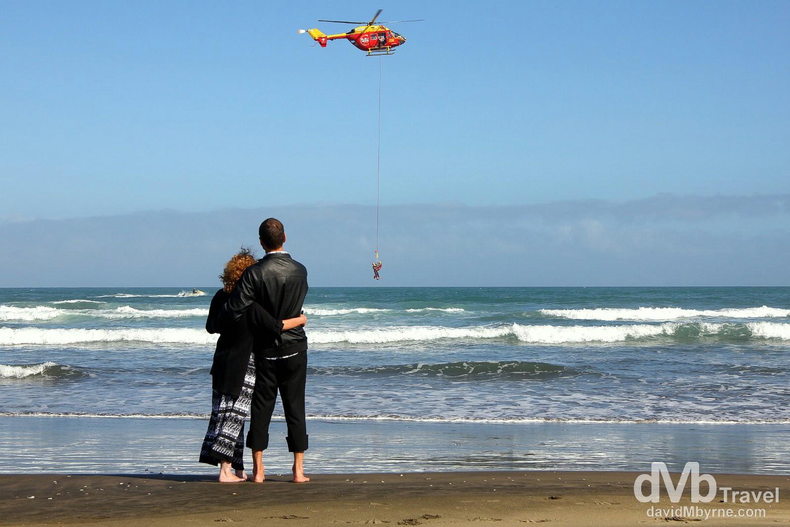 Coastguard rescue drills off the black sand Muriwai Beach, North Island, New Zealand. April 27th 2012.