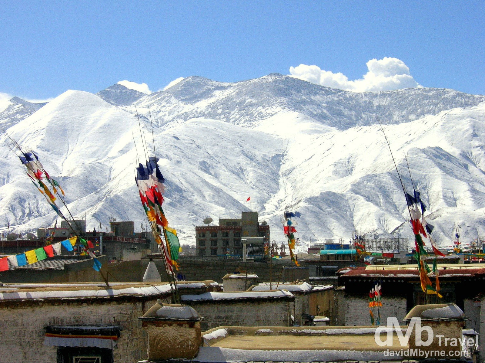 The view of the surrounding Himalaya Mountains from the rooftop of the Jokhang Temple, Lhasa, Tibet. February 27th 2008.