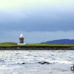 A lighthouse shortly after sunrise near the Rosses Point peninsula in County Sligo, Ireland. January 5, 2013.