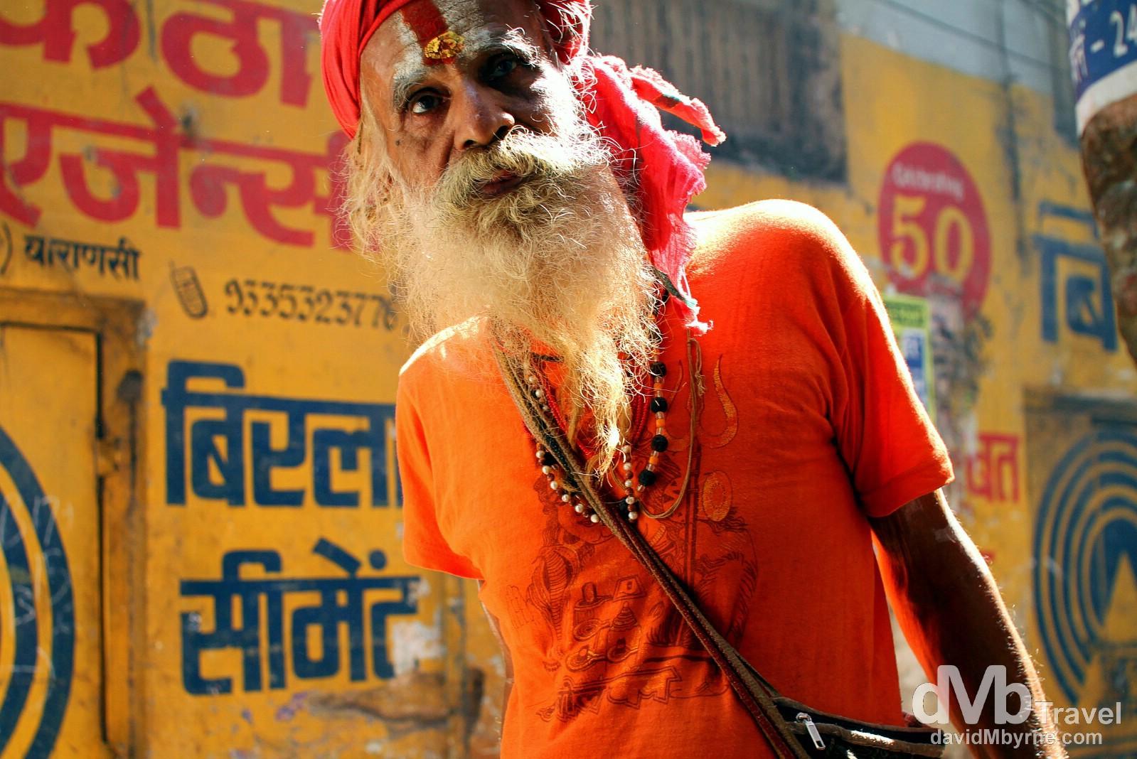 A sadhu, an ascetic Hindi holy man, in the narrow lanes of old town Varanasi, Uttar Pradesh, India. October 13th 2012.