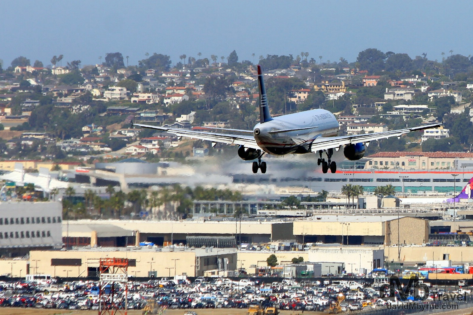 A plane coming in to land at San Diego International Airport as seen from Laurel Street. San Diego, California, USA. April 17th 2013.
