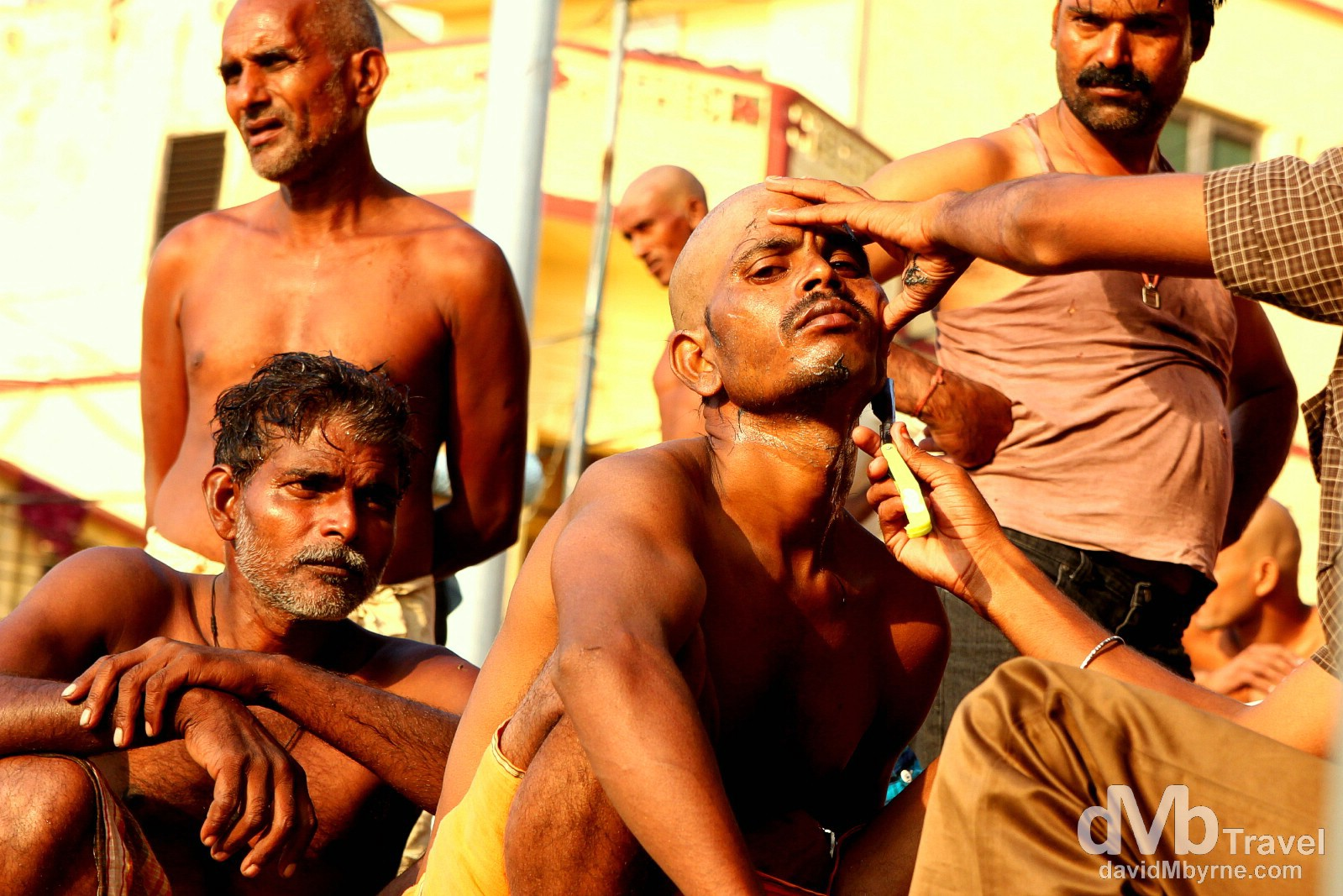 Getting a shave on the steps of a ghat by the Ganges River in Varanasi, Uttar Pradesh, India. October 13th 2012.