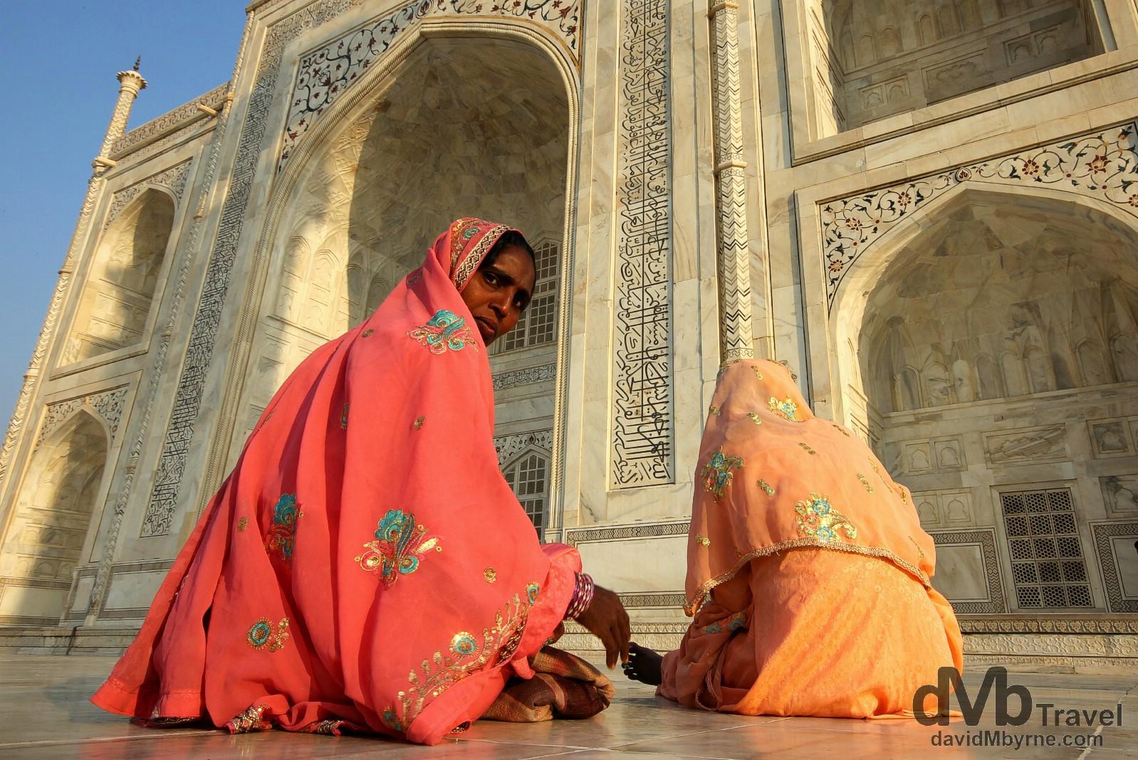 Sitting on the raised marble platform surrounding the Taj Mahal just after sunset. Agra, Uttar Pradesh, India. October 11th 2012.
