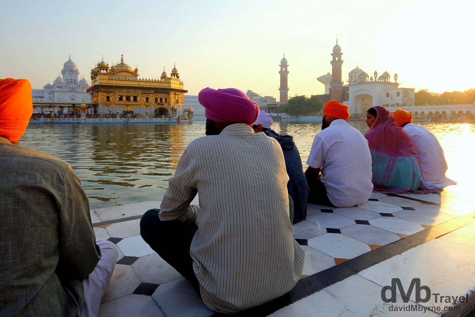 Sitting by the Amrit Sarovar (Pool of Nectar) at sunrise at the Golden Temple, Amritsar, India. October 9th 2012.