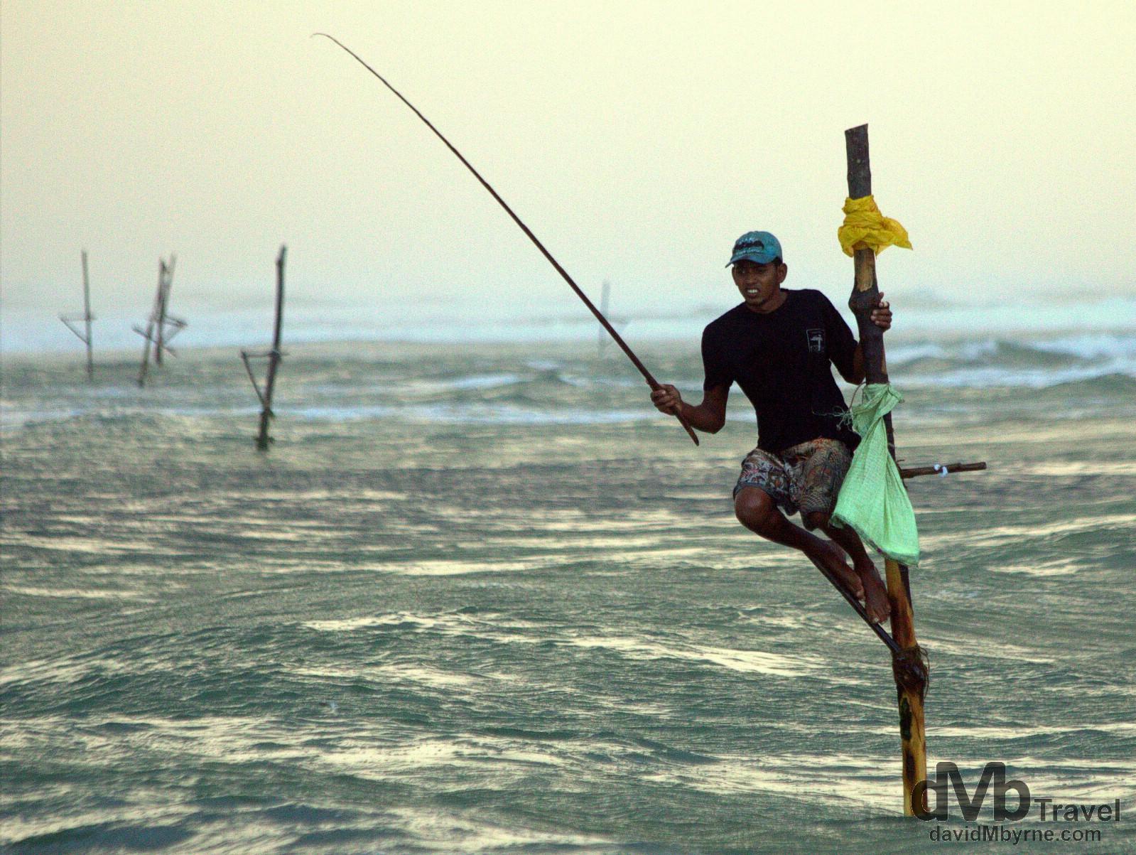 A stilt fisherman plying his craft outside the village of Koggala, southern Sri Lanka. September 2nd 2012.