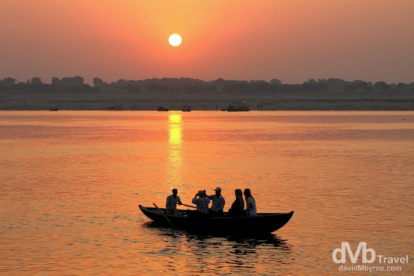 A tourist boat on the Ganges River at sunrise. Varanasi, Uttar Pradesh, India. October 13th 2012.
