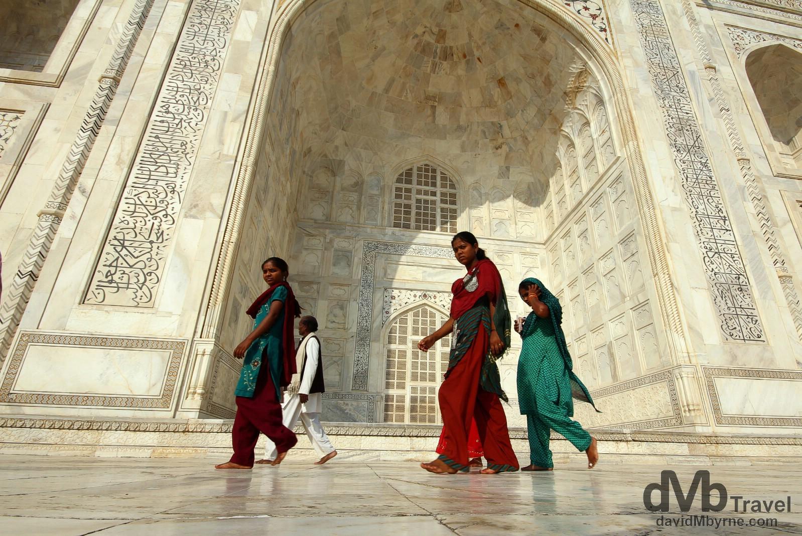 Walking on the raised marble platform surrounding the Taj Mahal in Agra, Uttar Pradesh, India. October 11th 2012.