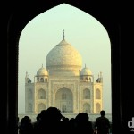 The Taj Mahal at sunrise as seen from under the arch of the South Gate. Agra, Uttar Pradesh, India. October 11th 2012.
