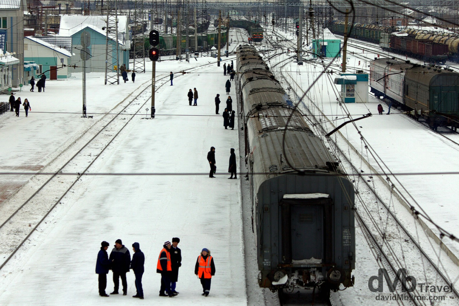 Train 037, minus its locomotive, sitting in Tayga train station as seen from a bridge spanning the station tracks. Tayga, Siberian Russia. November 12th 2012.