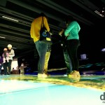 Visitors examining a huge illuminated floor map in Te Papa, Wellington, North Island, New Zealand. May 12th 2012.