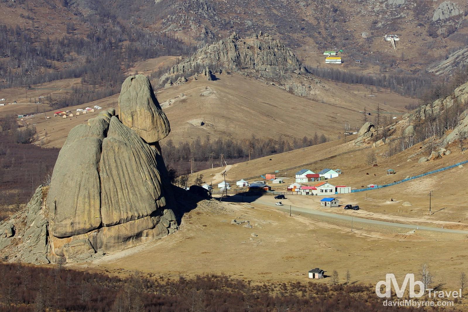 Turtle Rock overshadows a small settlement in Terelj National Park, Mongolia. November 3rd 2012.