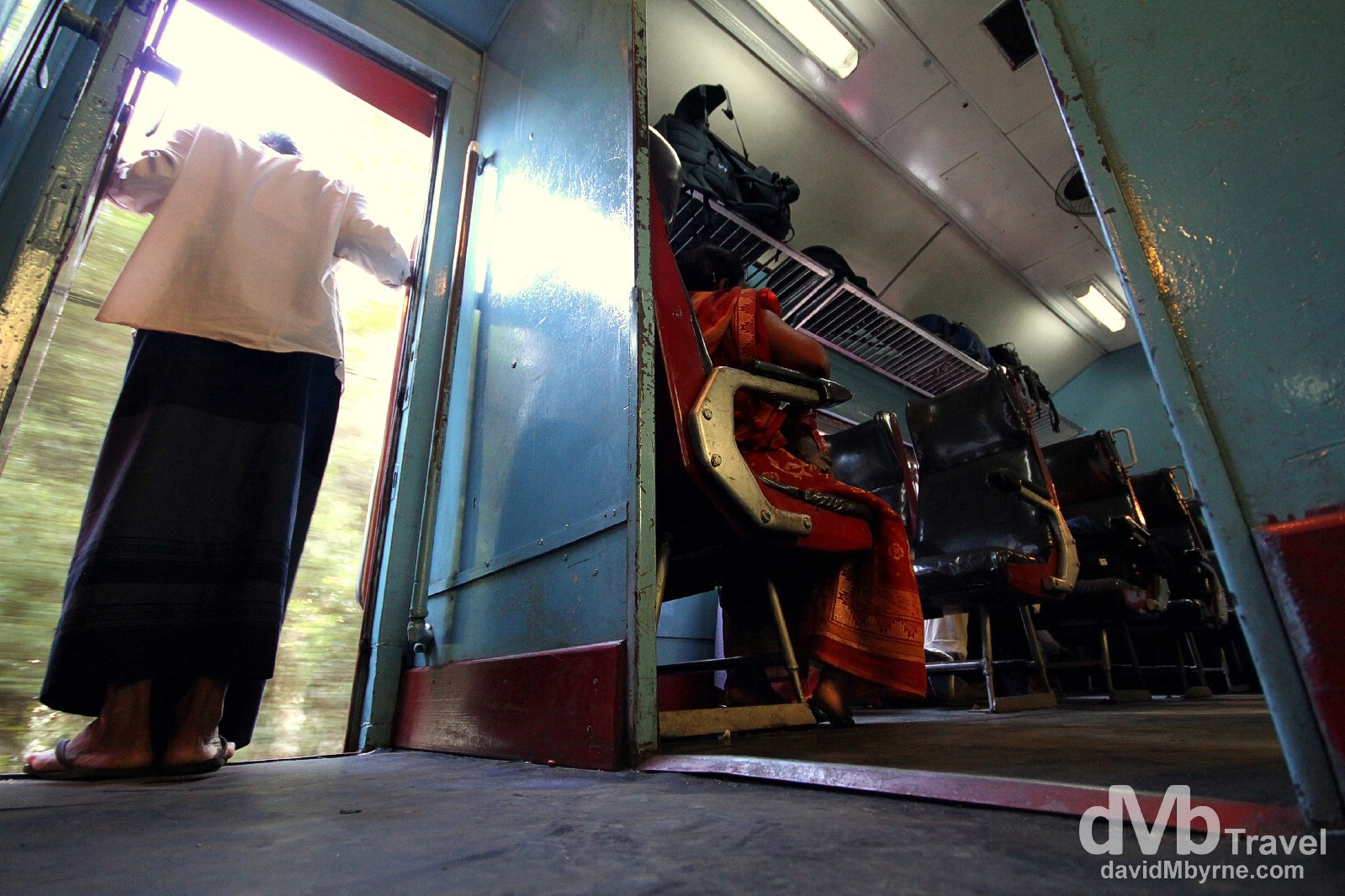 A sparsely populated second class carriage on the Badulla to Colombo train, Sri Lanka. September 5th 2012.