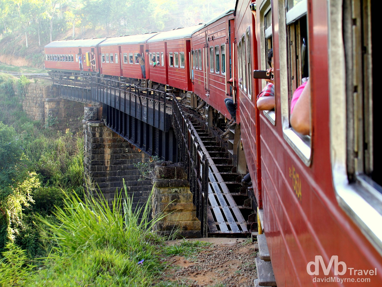 Sunrays over the rear of the Badulla to Colombo train as it crosses a bridge in central Sri Lanka. September 5th 2012.
