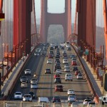 Early morning traffic on The Golden Gate Bridge as seen from Vista Point, San Francisco, California, USA. April 9th 2013.