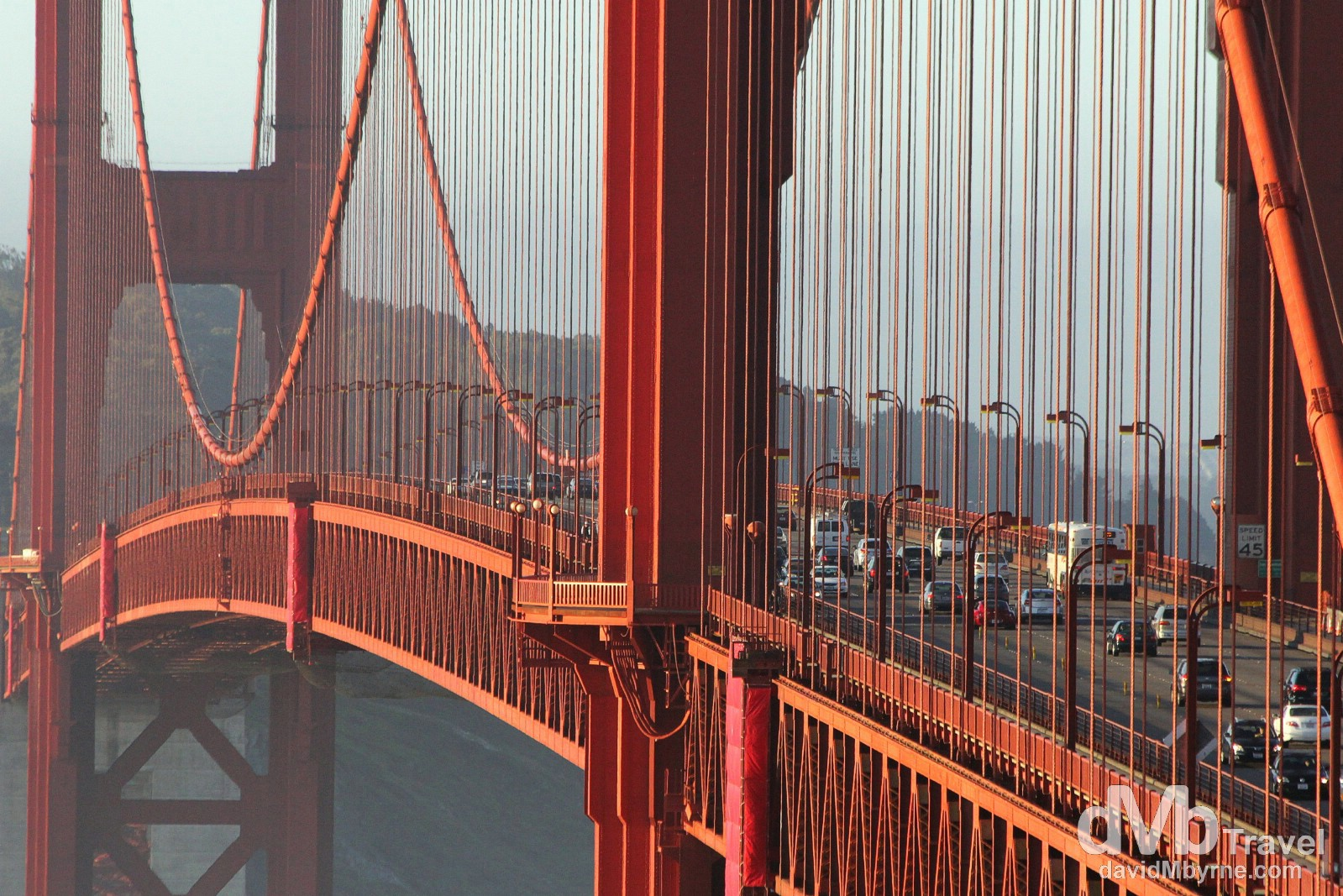 Sunrise light illuminates the span of The Golden Gate Bridge as seen from Vista Point on the north-eastern side of the bridge. San Francisco, California, USA. April 11th 2013.