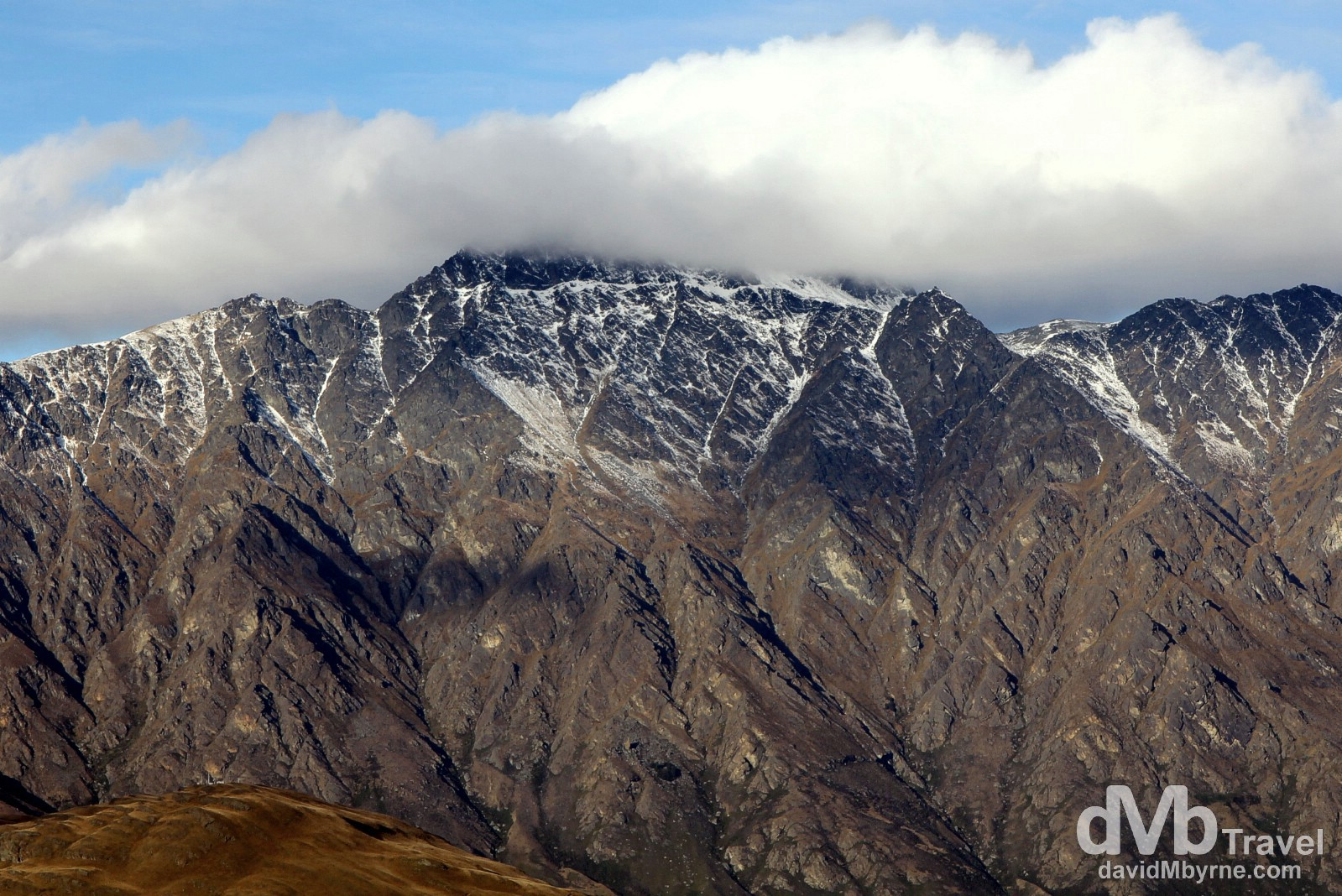 Clouds cover the summit of The Remarkables mountain range as seen from Bob's Peak in Queenstown, South Island, New Zealand. May 23rd 2012.
