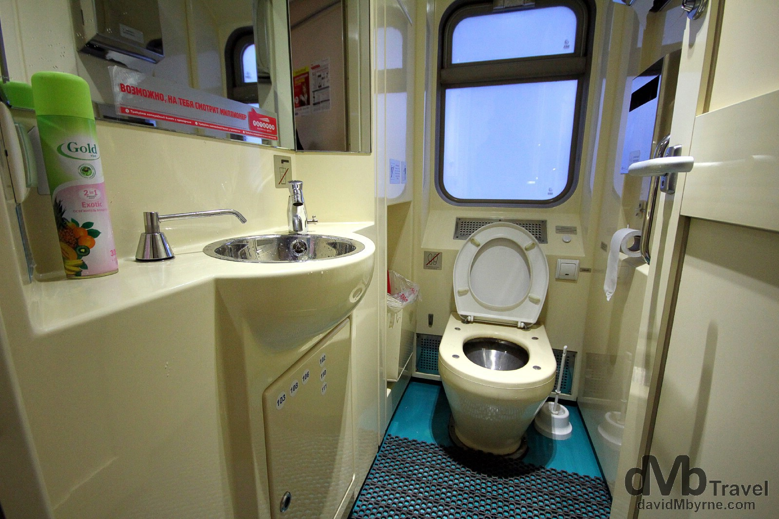 Yes, it's a toilet, the one at the end of my train carriage. Everything is clean & works. And there's even air freshener. The toilet is one of those noisy suction jobs found on aeroplanes meaning, & unlike older rolling stock which simply discards whatever is deposited right onto the tracks, toilets are not locked in the vicinity of stations. Nirvana for some. On the train from Tomsk to Nizhny Novgorod, Russia. November 14th 2012.