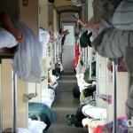 Inside a Russian third class, or platzkart, carriage en route from Irkutsk to Tomsk, Siberian Russia. November 10th 2012.