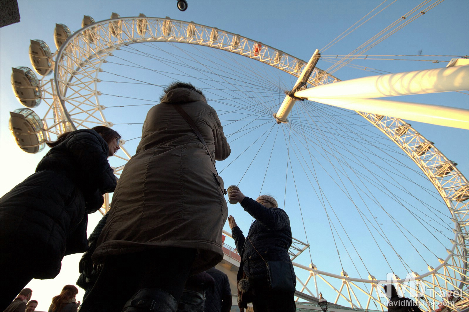 Standing under the London Eye Ferris wheel on the banks of the Thames River in London, England. December 8th 2012.